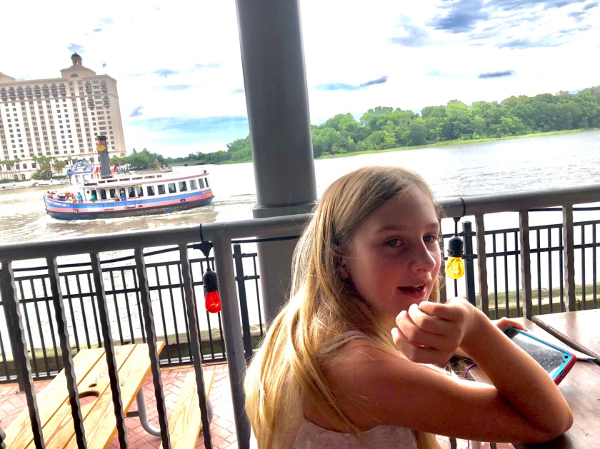 Jayda overlooking Savannah River on deck at Joes Crab Shack River Street Savannah