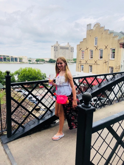 Jayda walking across bridge overlooking River Street Savannah Historic District